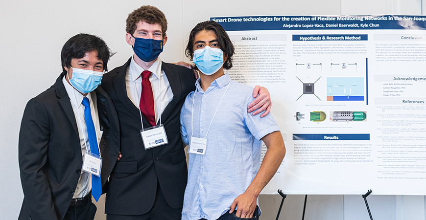 Incoming freshman Kyle Chun (mechanical engineering), third-year Daniel Baerwaldt (chemistry) and first-year Alejandro Lopez-Vaca (engineering) in front of their presentation.